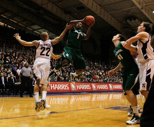 Kalin Lucas #1 of the Michigan State Spartans leaps to shoot over Michael Thompson #22 of the Northwestern Wildcats on January 2, 2010 at Welsh-Ryan Arena in Evanston, Illinois.