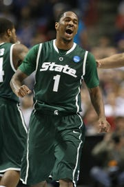 Kalin Lucas #1 of the Michigan State Spartans reacts after a teammate scored against the Maryland Terrapins during the second round of the 2010 NCAA men's basketball tournament at the Spokane Arena on March 21, 2010 in Spokane, Washington.