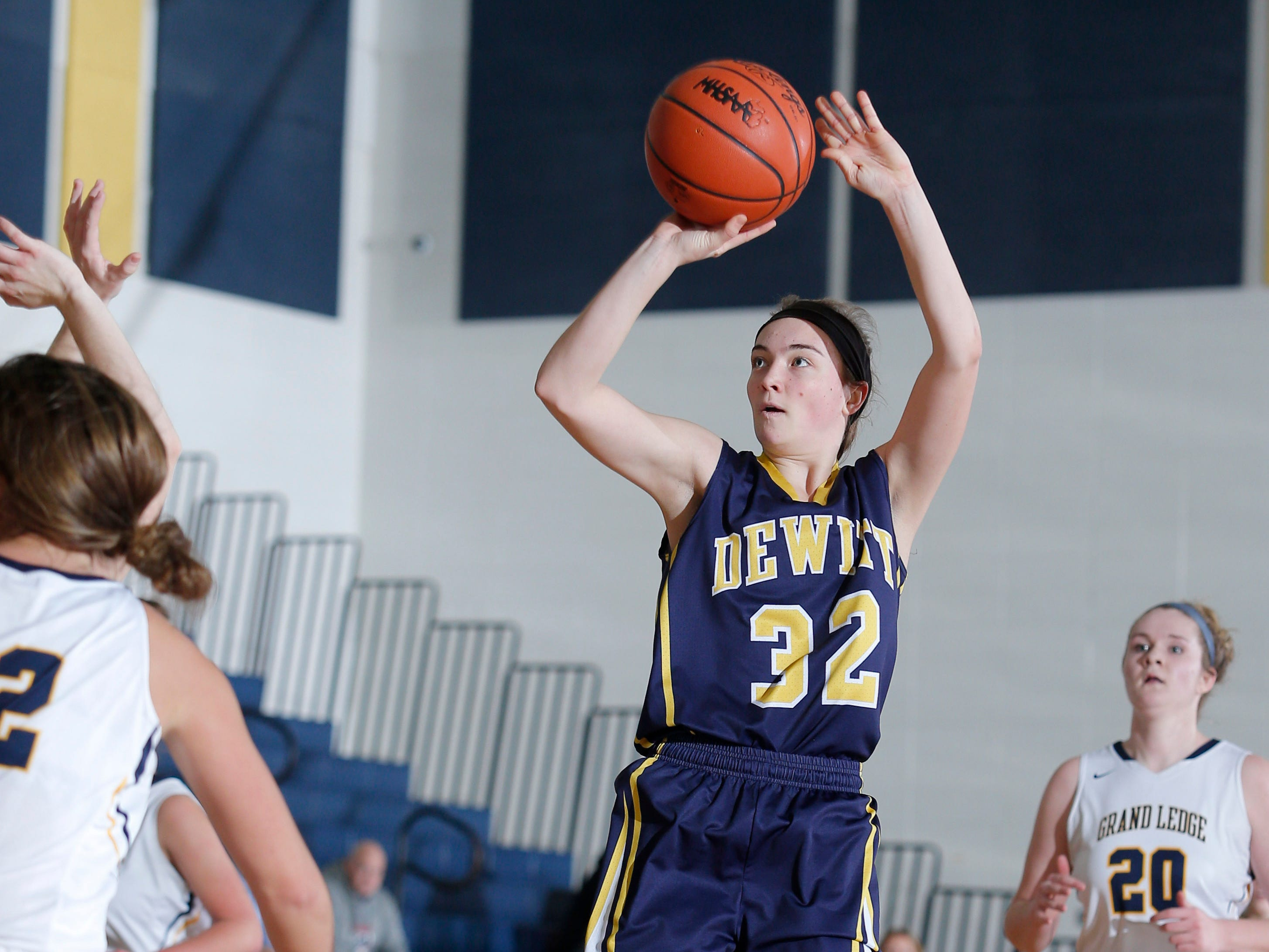 DeWitt's Maddie Petersen (32) shoots against Grand Ledge, Tuesday, Jan. 15, 2019, in Grand Ledge, Mich.