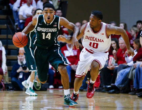 Gary Harris #14 of the Michigan State Spartans dribbles up court as Evan Gordon #10 of the Indiana Hoosiers defends at Assembly Hall on January 4, 2014 in Bloomington, Indiana. Michigan State defeated Indiana 73-56.