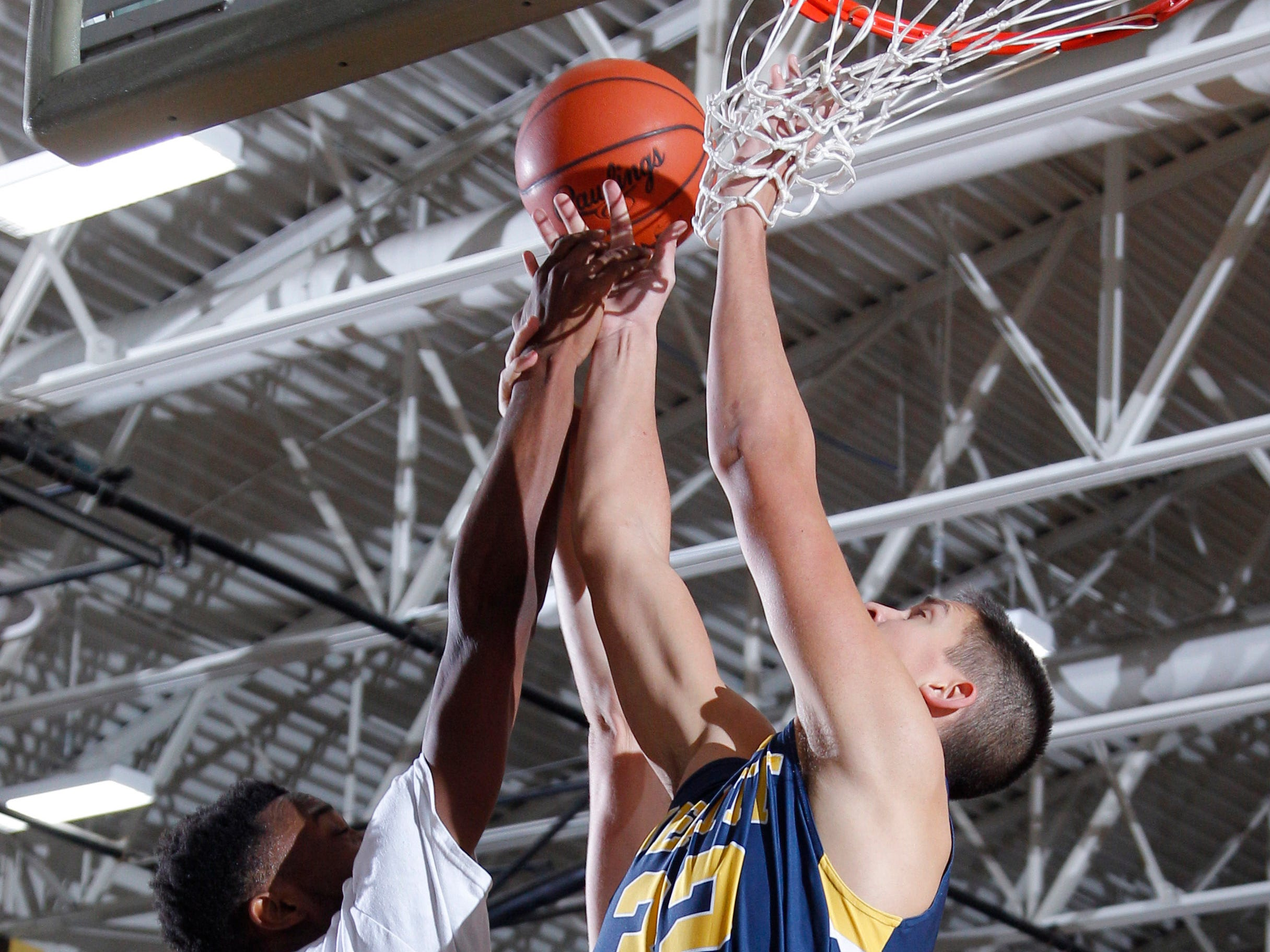 DeWitt's Mason Gilbert, right, and Grand Ledge's Javel Lewis vie for a rebound, Tuesday, Jan. 15, 2019, in Grand Ledge, Mich.