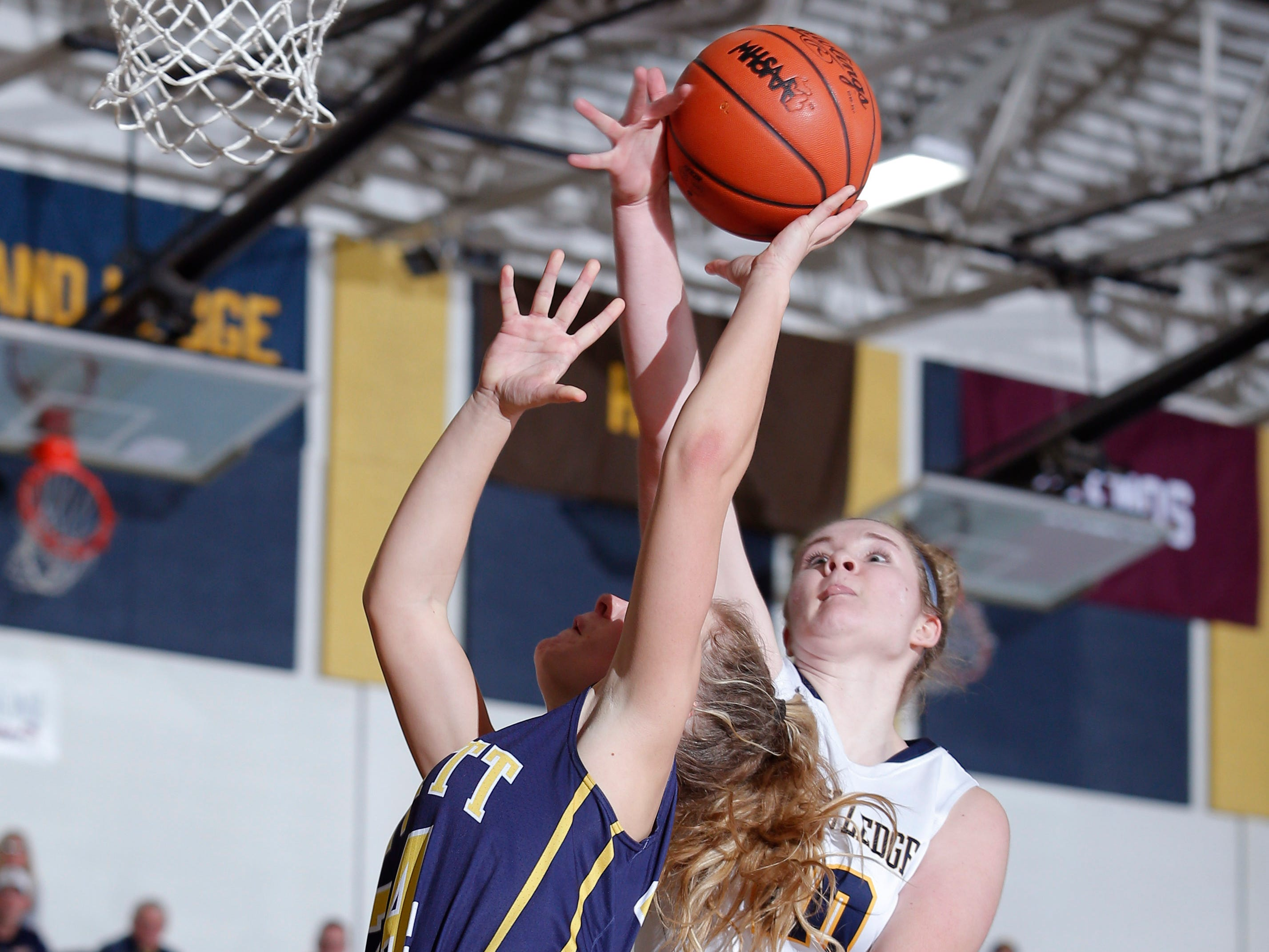 Grand Ledge's Courtney Sharland, right, blocks a shot by DeWitt's Annie McIntosh, Tuesday, Jan. 15, 2019, in Grand Ledge, Mich.