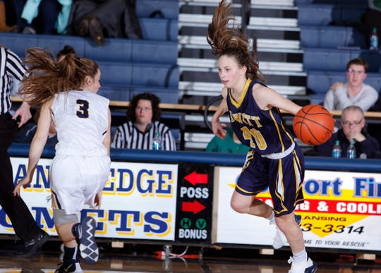DeWitt's Isabelle Gilmore, right, drives against Grand Ledge's Makenzie Todd, Tuesday, Jan. 15, 2019, in Grand Ledge, Mich.