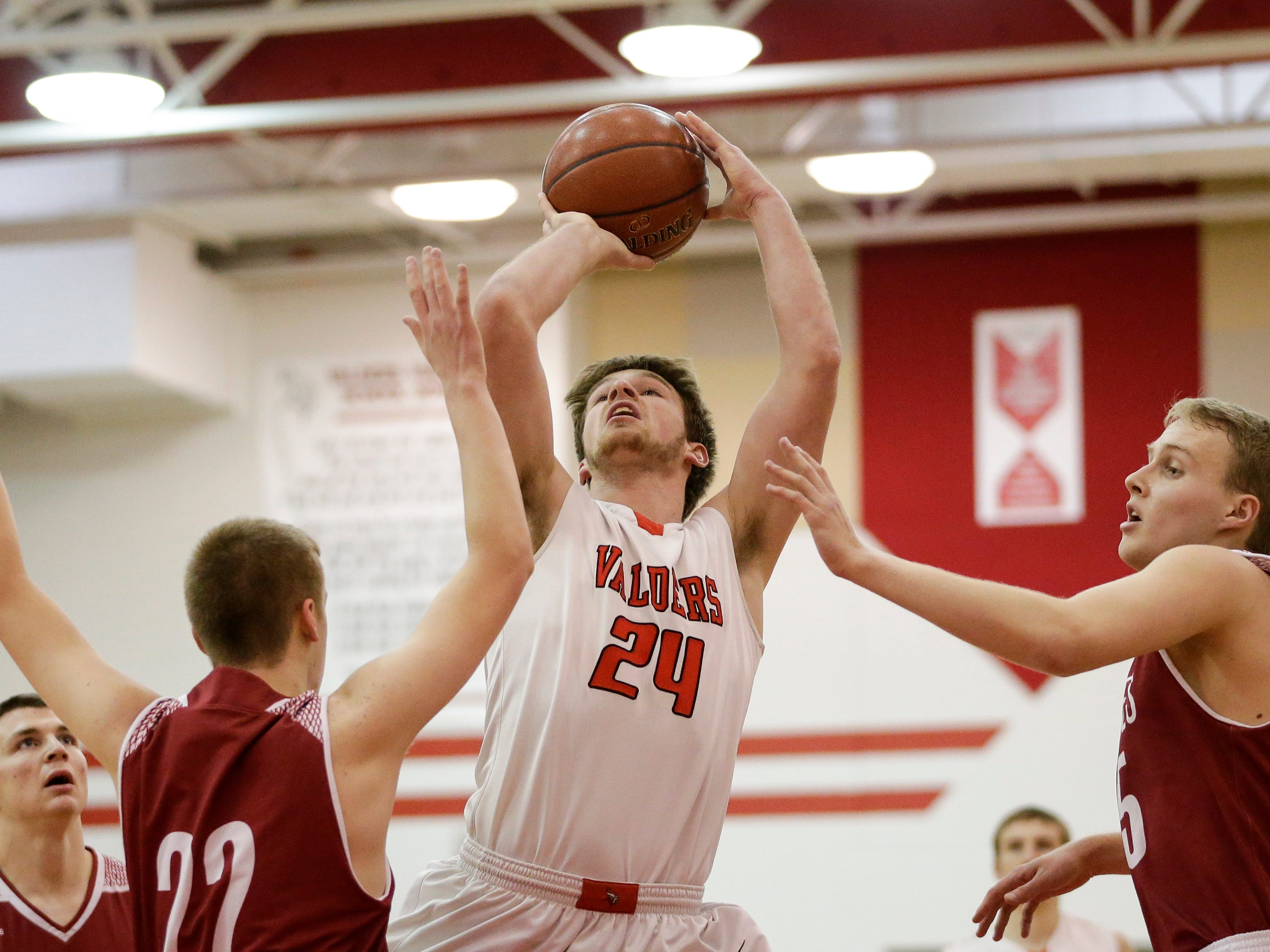 Valders' Fletcher Dallas shoots against New Holstein during an EWC matchup at Valders High School Tuesday, January 15, 2019, in Valders, Wis. Joshua Clark/USA TODAY NETWORK-Wisconsin