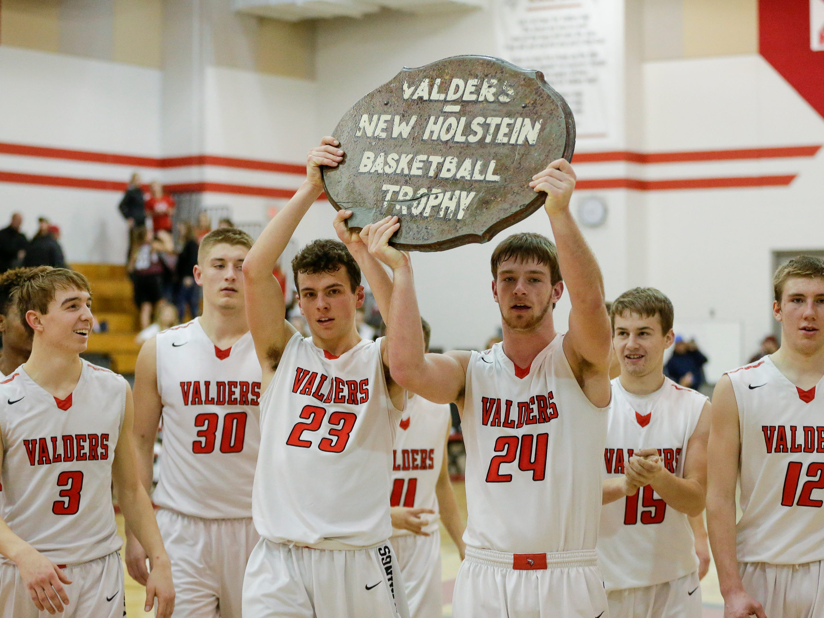 Valders hoists up the coveted Table Top trophy after defeating rival New Holstein in an EWC matchup 55-50 at Valders High School Tuesday, January 15, 2019, in Valders, Wis. The Table Top trophy rivalry game dates back to 1933 well before the teams were in the same conference. Joshua Clark/USA TODAY NETWORK-Wisconsin