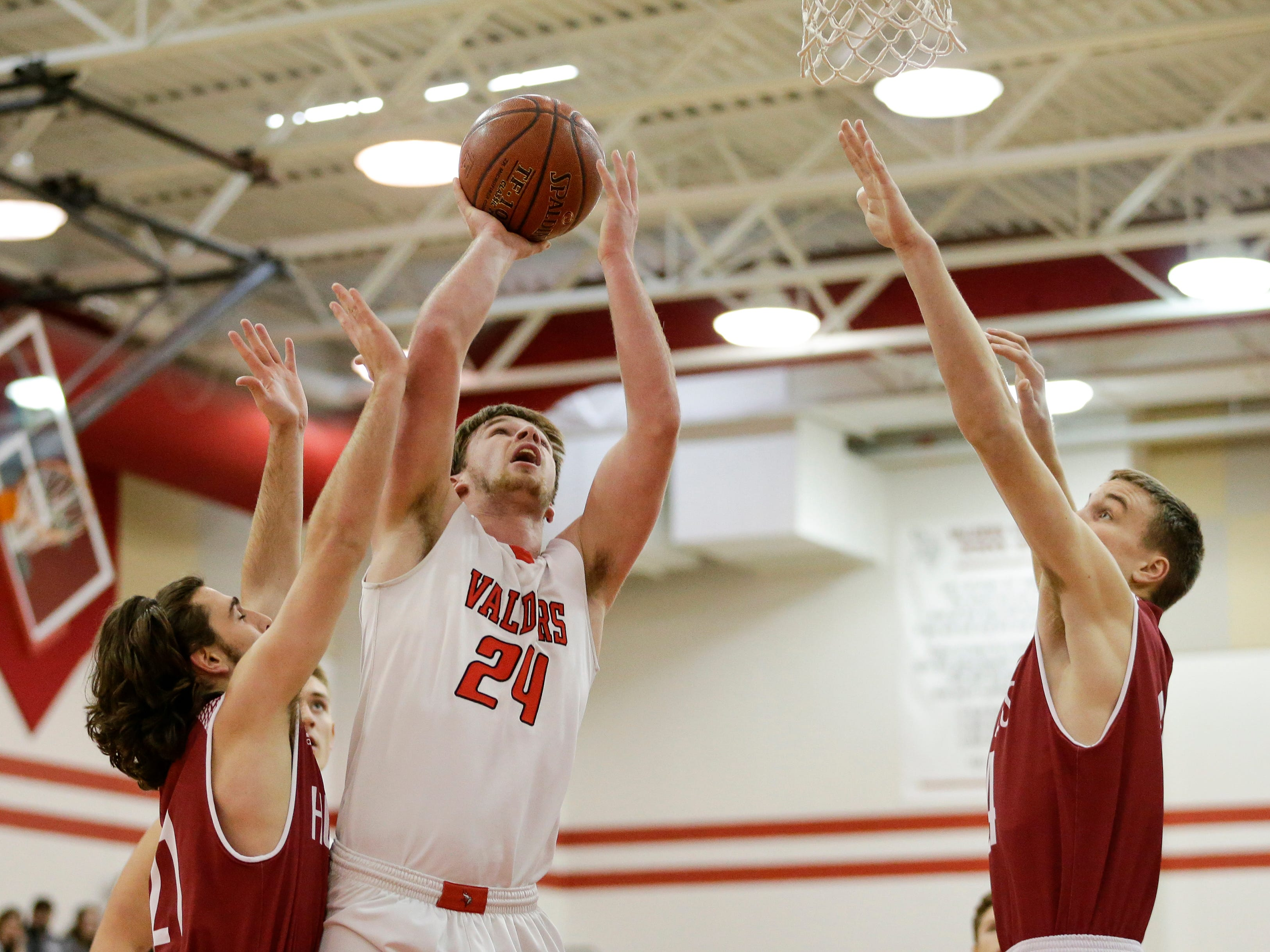 Valders' Fletcher Dallas shoots over New Holstein during an EWC matchup at Valders High School Tuesday, January 15, 2019, in Valders, Wis. Joshua Clark/USA TODAY NETWORK-Wisconsin