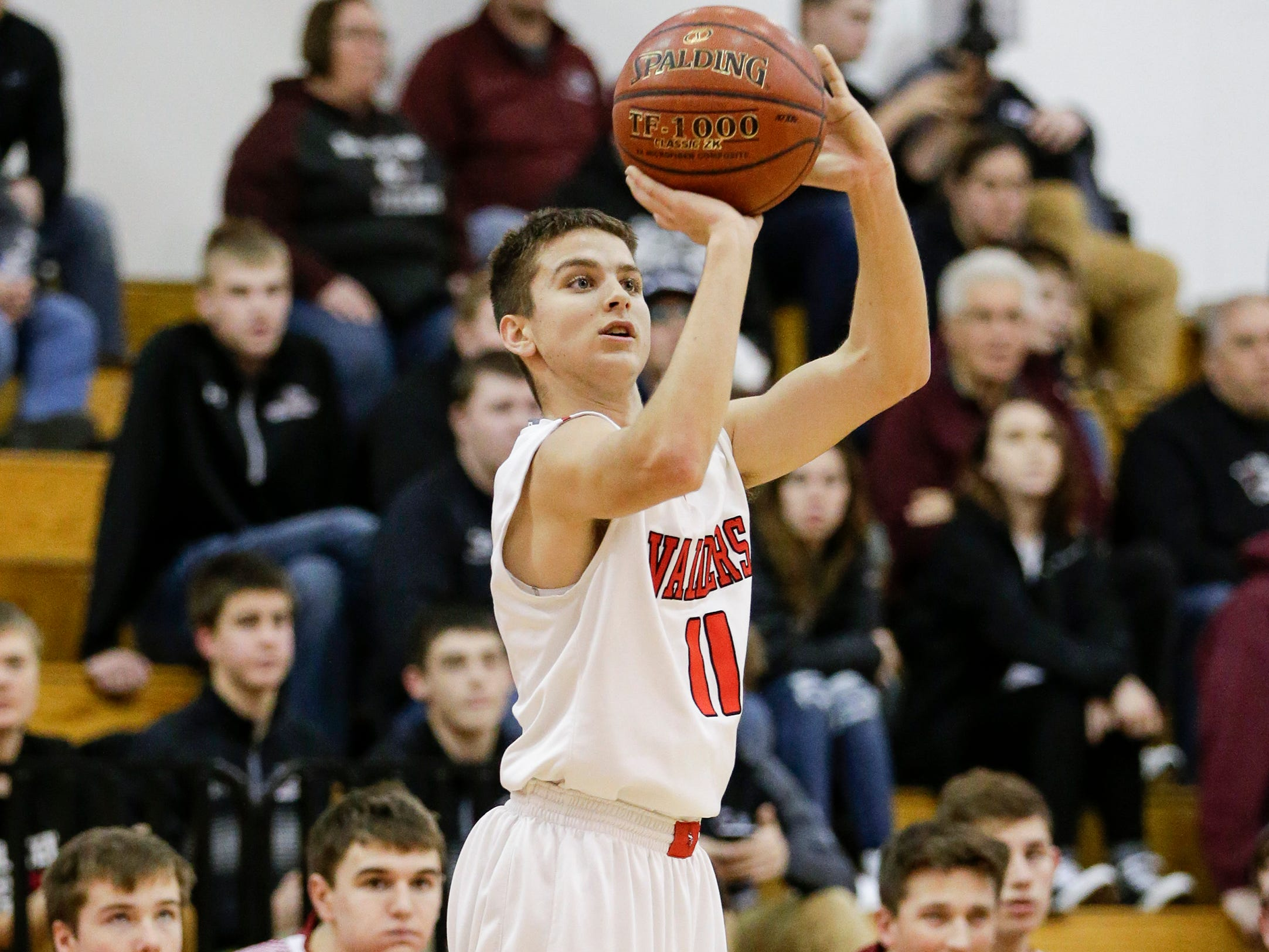 Valders' Riley Hammel (11) sinks a three point shot against New Holstein during an EWC matchup at Valders High School Tuesday, January 15, 2019, in Valders, Wis. Joshua Clark/USA TODAY NETWORK-Wisconsin