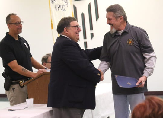 "Joseph Schokatz shakes the hand of Judge Frank Ardis during the Veterans' court graduation ceremony on Wednesday. Schokatz told graduates about the path of recovery, ""The past is in your head, but the future is in your hands."""