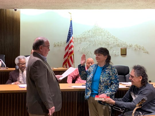 Jean Taddie is sworn in by council President Phil Scott on Jan. 15 to serve out the remainder of sixth-ward councilmember Garnetta Pender's term, which ends Dec. 31, 2019.