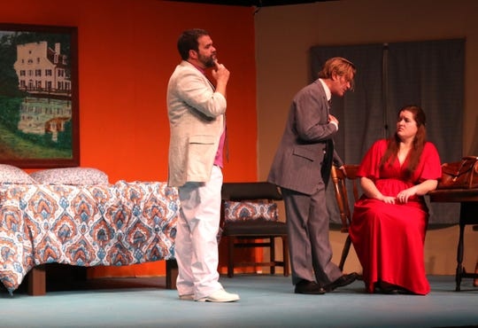 """Ryan Kiley, Beau Roberts and Lindsay Shoup  rehearse a scene from """"Murder at the Howard Johnson's"""" at the Mansfield Playhouse."""