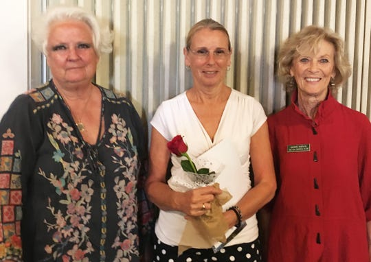 President Sandy Wallen presided over the business meeting, at which new member Linda Ariel was inducted to the club by presentation of a certificate, the club membership book and calendar, her official name tag, and a rose. Above: Wallen, Ariel and Jackie Purvis.