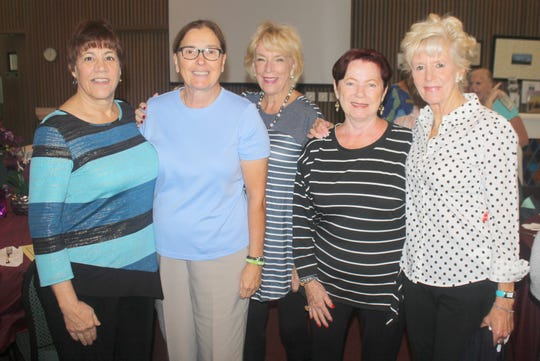 Pam Cote, Charlotte Roman, Litha Berger, Susan Lamonica and Jane Demado discuss life on Tigertail Beach.
