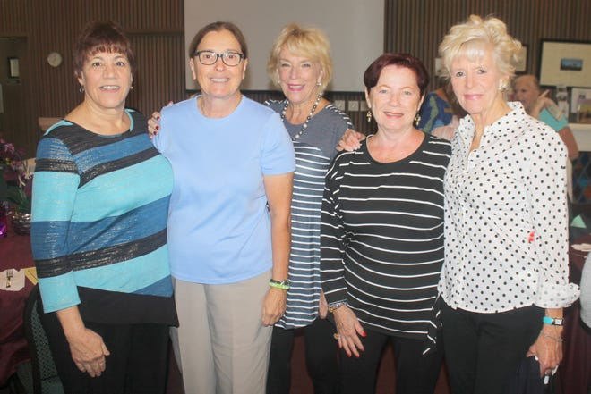 Pam Cote, Charlotte Roman, Litha Berger, Susan Lamonica and Jane Demado discuss life on Tigertail Beach.