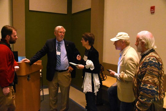 Dr. Bill Mitsch talks to audience members after his lecture at the Naples Botanical Garden's Kapnick Center on Jan. 10, on red tide outbreaks' causes and possible mitigation. Red tide has caused great concern in Southwest Florida, as the algae blooms have brought fish kills and affected tourism.