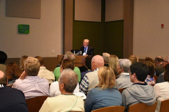 Dr. Bill Mitsch speaks to a capacity crowd at the Naples Botanical Garden's Kapnick Center on Jan. 10, on red tide outbreaks' causes and possible mitigation. Red tide has caused great concern in Southwest Florida, as the algae blooms have brought fish kills and affected tourism.