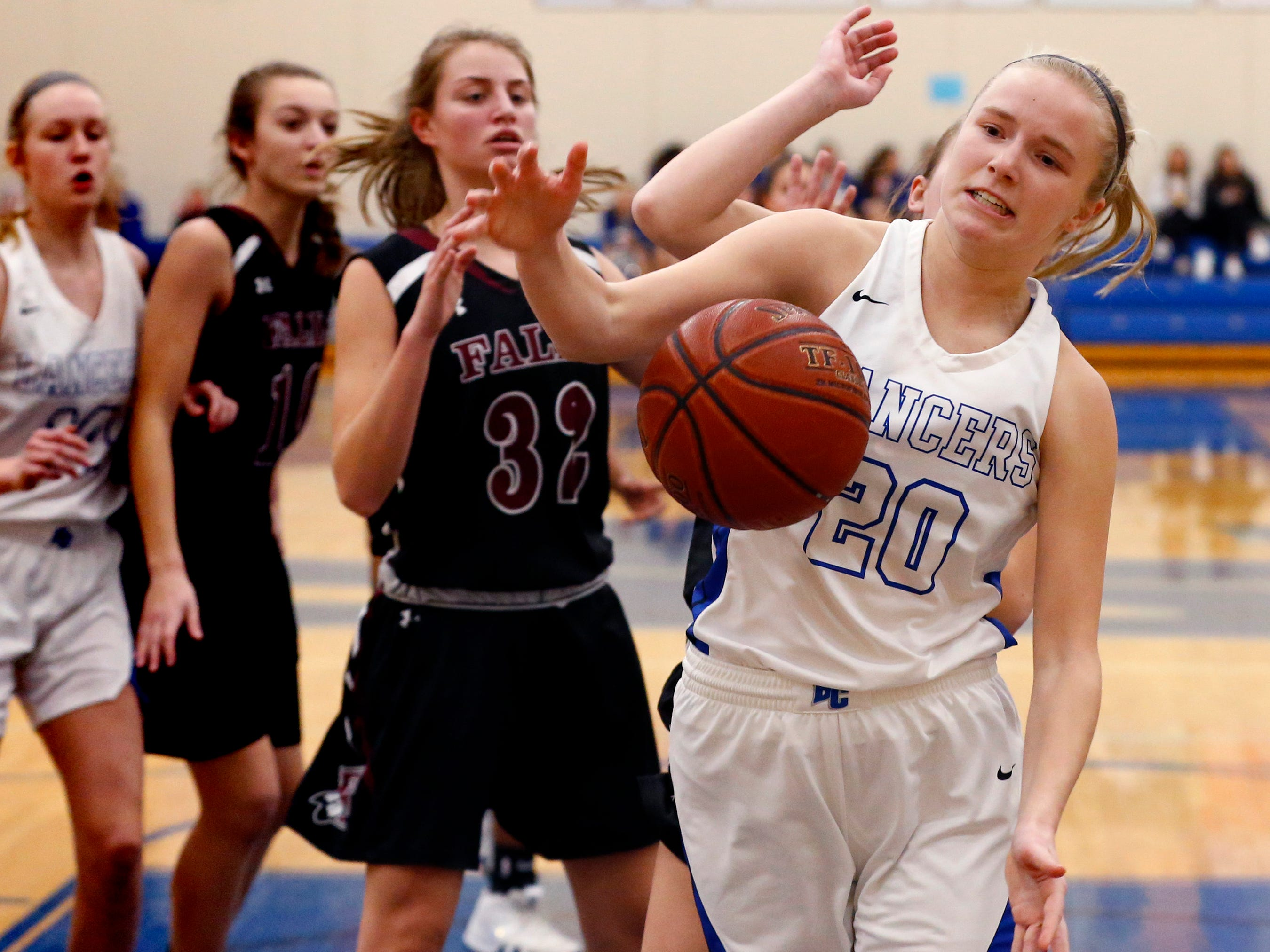 Brookfield Central's Emily Busch looks to corral a rebound in the Lancers' game against Menomonee Falls at Central on Jan. 15.