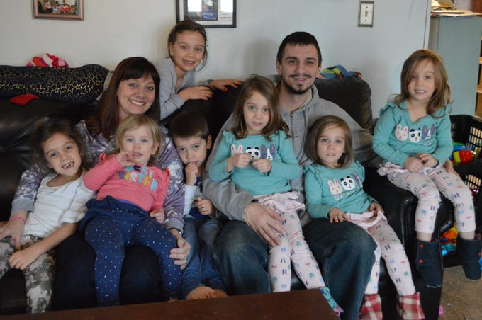 Brian and Alison Strandt are raising seven children under the age of 7 while running a business out of their Greenfield home.