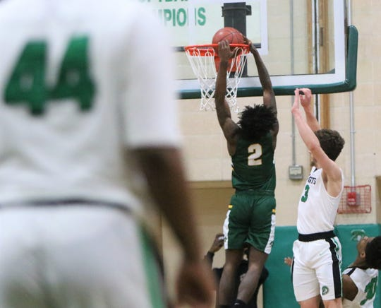 Martin Luther's Ace Evans flushes a two-handed dunk on the fastbreak in a game against Dominican on Jan. 15.