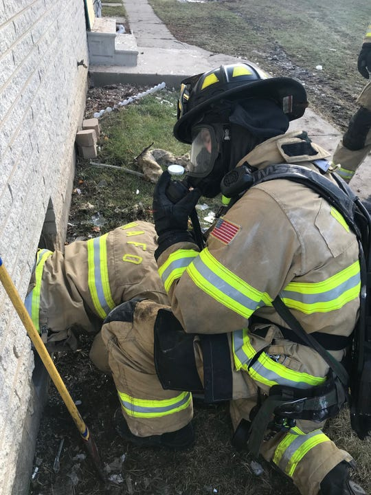 A technique involving cutting a hole in a wall to rescue a trapped firefighter is practiced by West Allis firefighters.