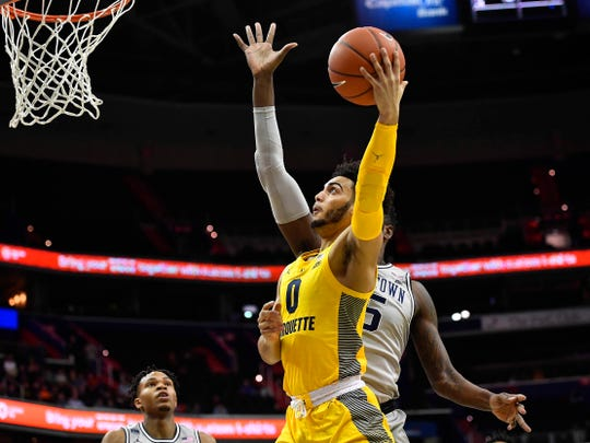 Marquette Golden Eagles guard Markus Howard (0) attempts a shot against the Georgetown Hoyas during the first half at Capital One Arena