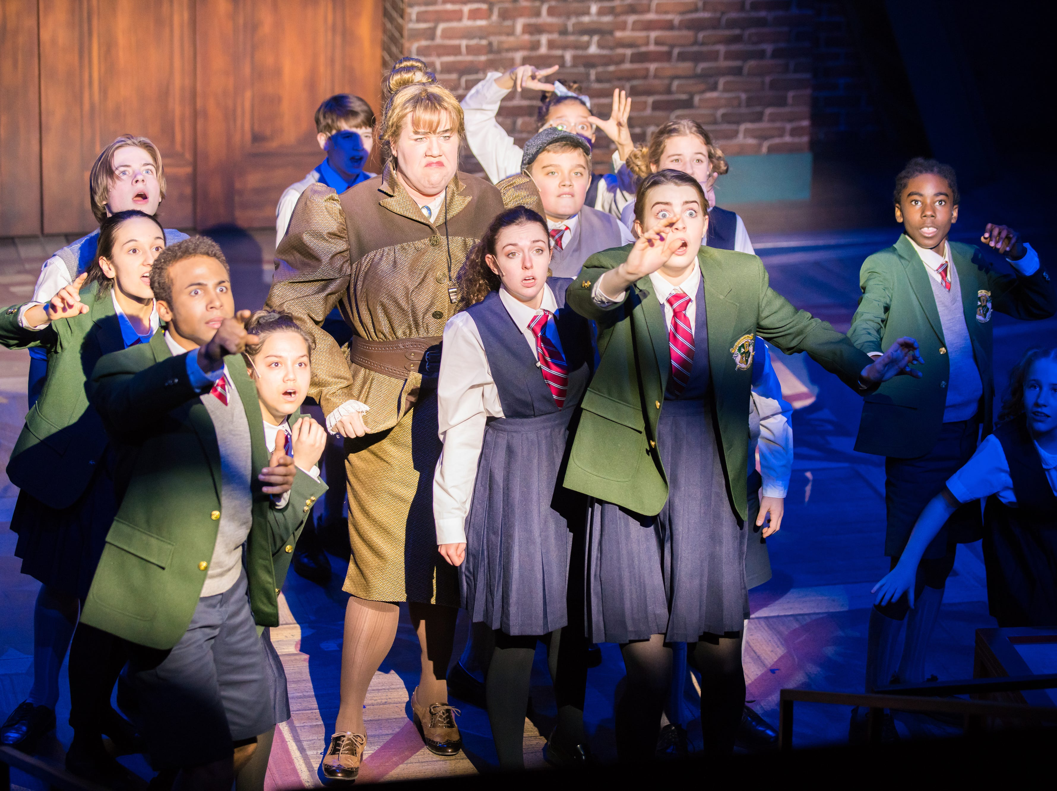 """The kids are amazed and intimidated by the power of Kelly Doherty in First Stage's """"Matilda."""""""