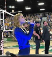 Germantown High School freshman Elise Dahlby sings the national anthem at the boys state volleyball championship in November 2018.