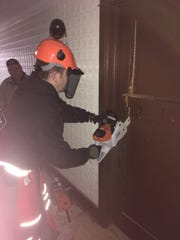 West Allis police SWAT leader Sergeant Tim Gold tests one of the brands of chain saws that the police department might buy. The SWAT team is looking for a saw that would tear through a thick door and be able to deal with whatever is used to barricade that door.