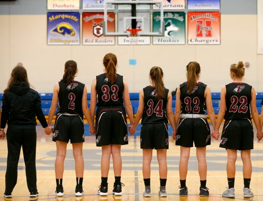 Menomonee Falls lines up for the national anthem to start its game at Brookfield Central on Jan. 15.
