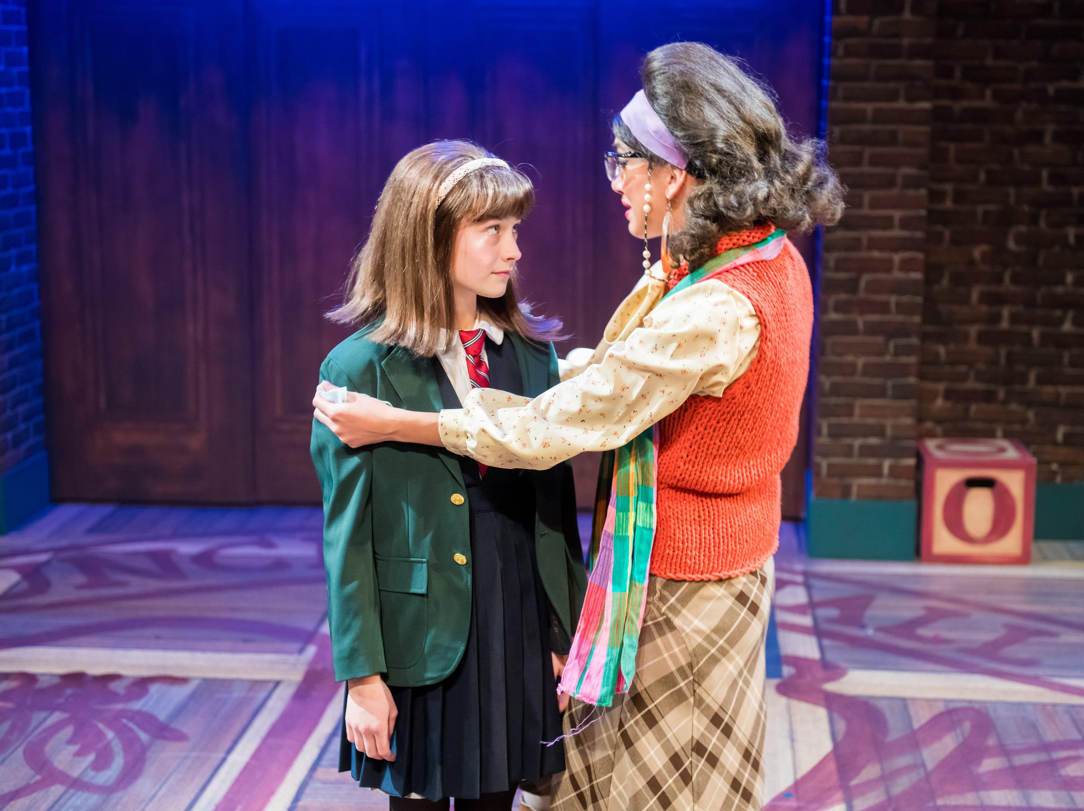 "Solana Ramirez-Garcia (right) comforts Marina Evans in First Stage's ""Matilda."""