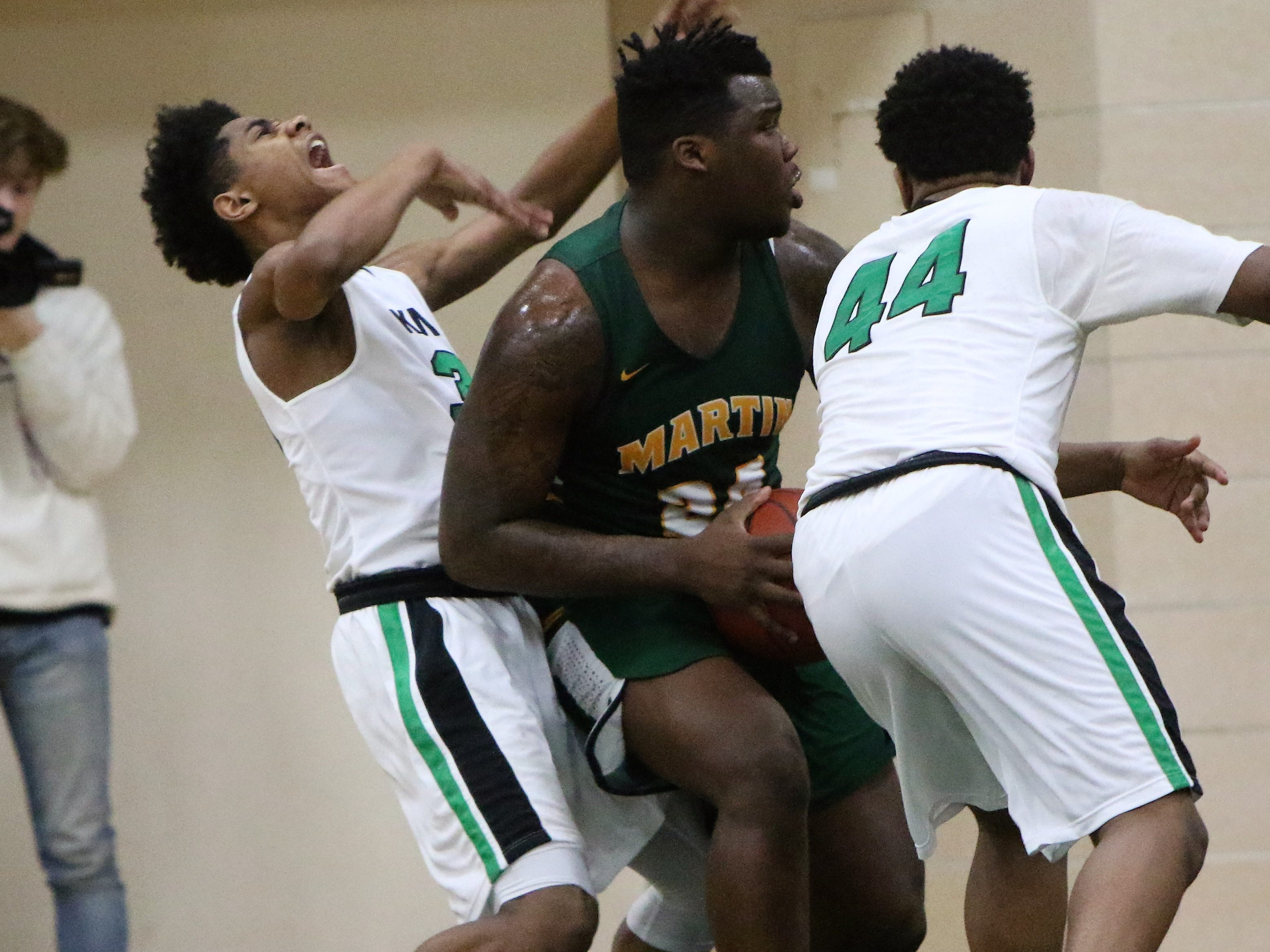 Dominican guard Ronald Kirk Jr. attempts to take a charge from Martin Luther forward Jeramie King on Jan. 15, 2019.