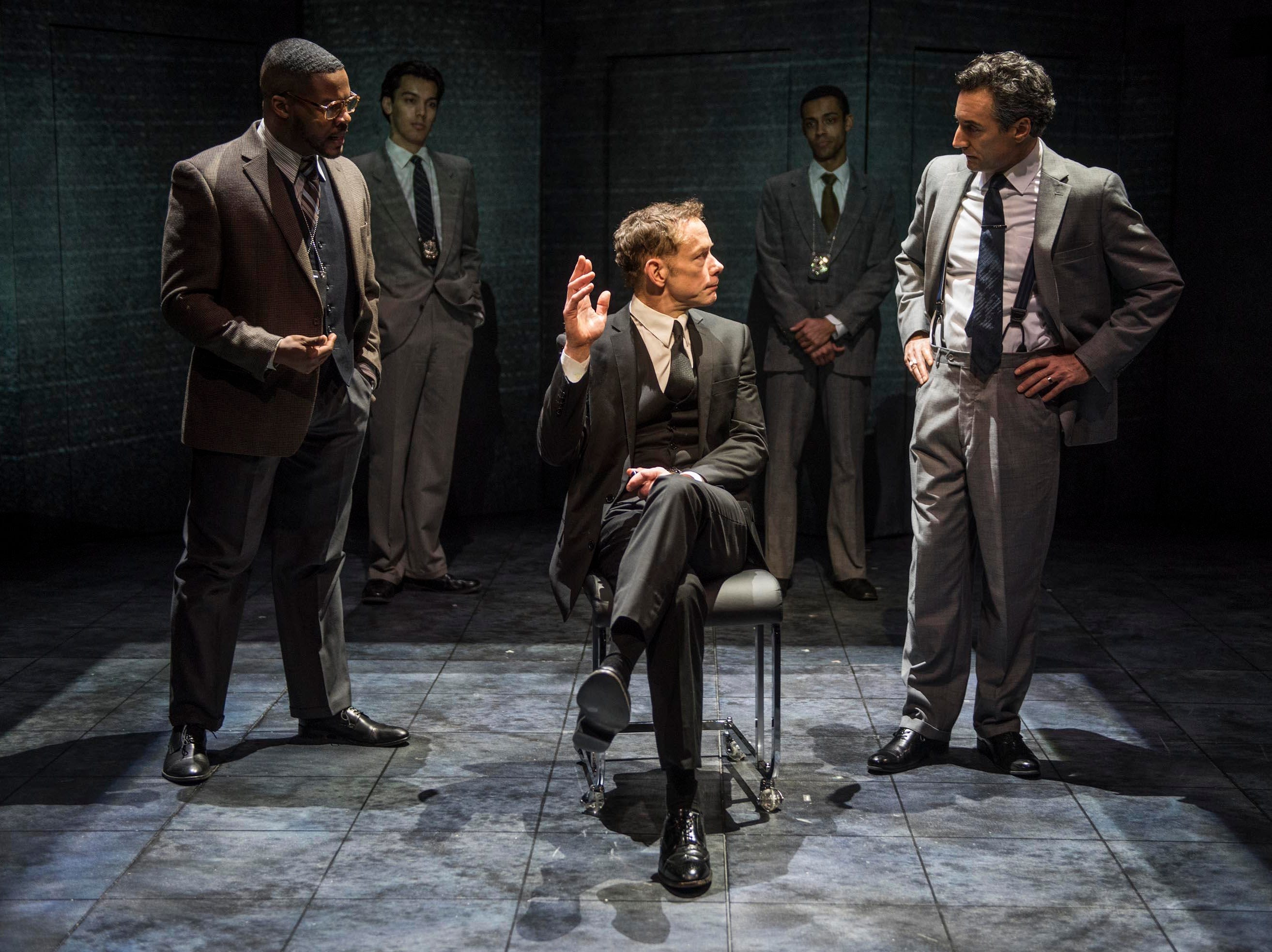 """DiMonte Henning, Jonathan Wainwright and Dominic Comperatore perform in Ayad Akhtar's """"Junk,"""" staged by Milwaukee Repertory Theater through Feb. 17 at the Quadracci Powerhouse, 108 E. Wells St."""