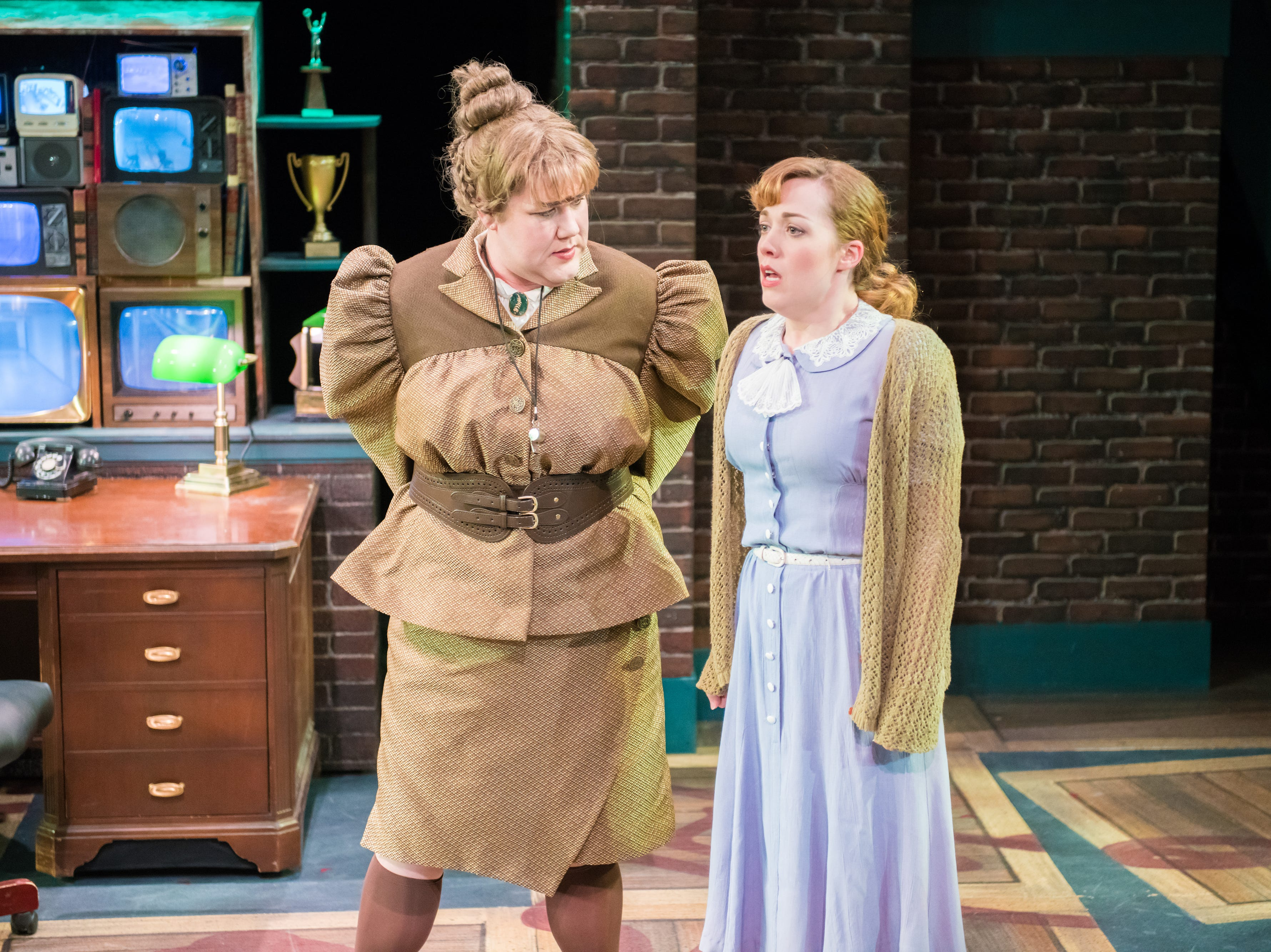 """Kelly Doherty (left) listens to Elizabeth Telford in First Stage's """"Matilda."""""""