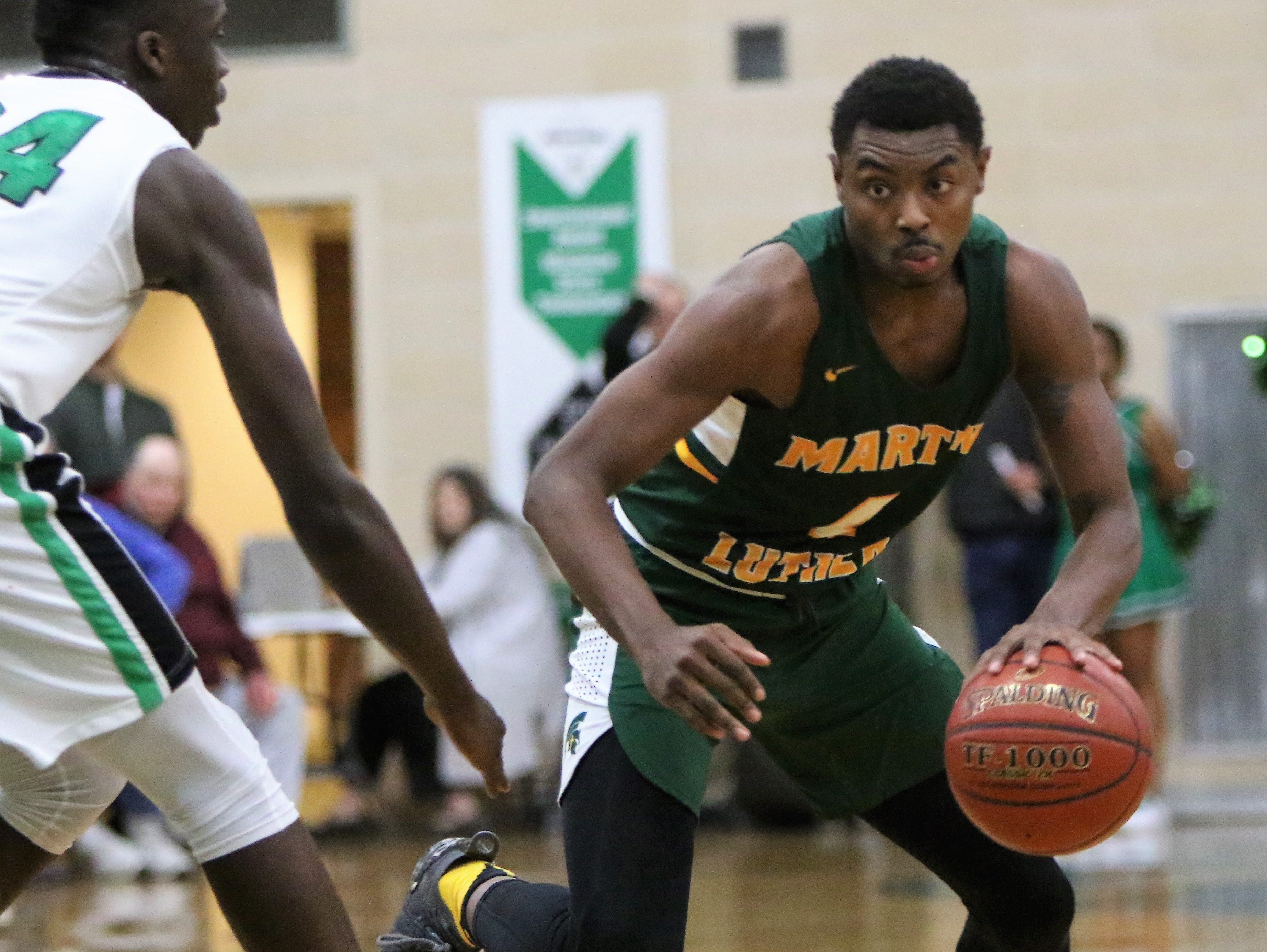 Martin Luther forward Xzavier Jones attempts to drive to the basket against Dominican on Jan. 15, 2019.