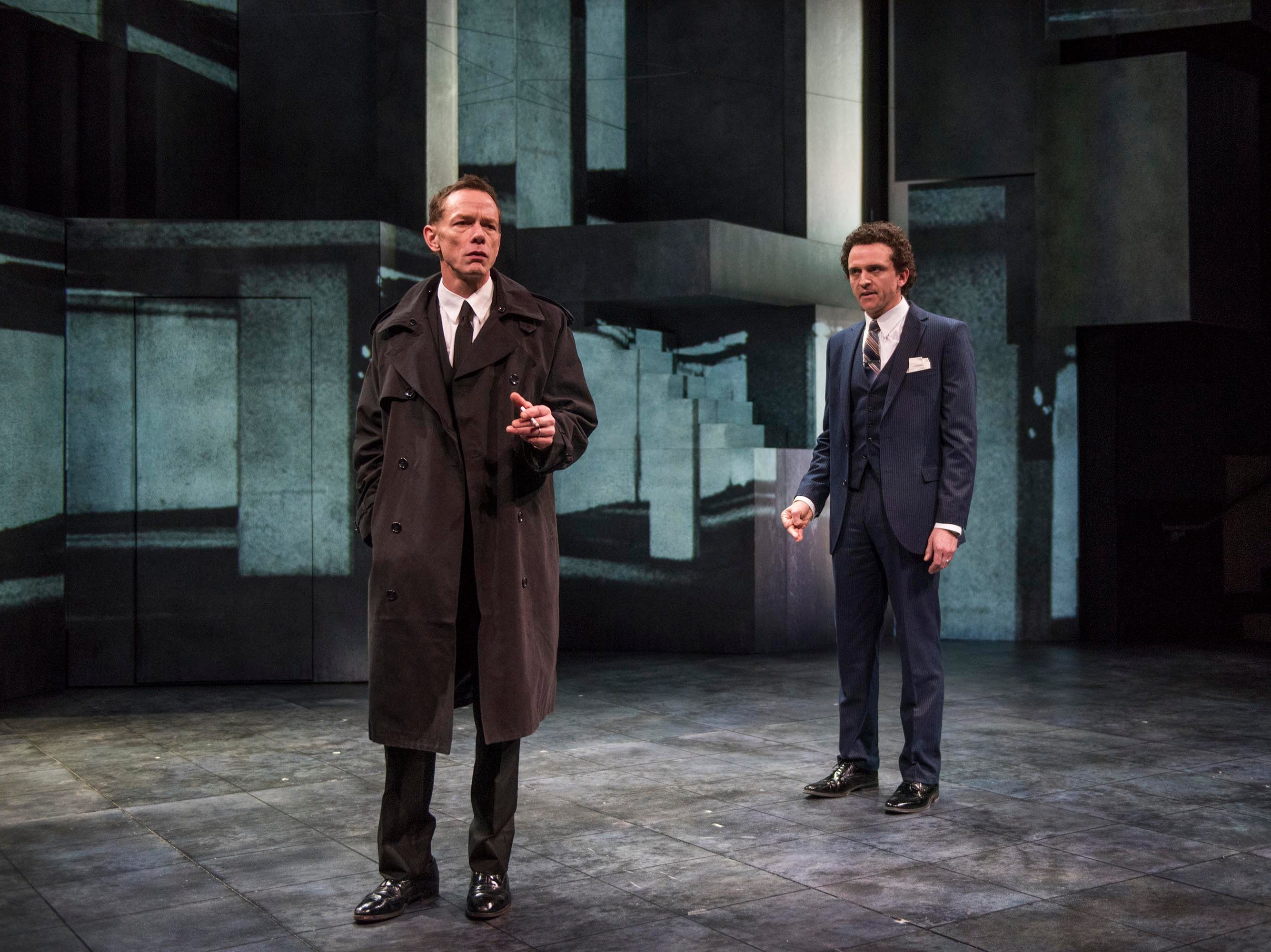 "Jonathan Wainwright and Gregory Linington have words in Ayad Akhtar's ""Junk"" through Feb. 17 at the Quadracci Powerhouse, 108 E. Wells St."