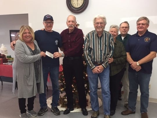 The Northeast Lakeside Fire Department Auxiliary board recently presented a check to the Fire Department in the amount of $20,000. These funds will help improve training and equipment. Pictured are: (from left) Kathy Guisenger; Fire Chief Henry Porter; Auxiliary President Hart Rowland; Eddie Danhauer; Pam Sallese; Tom Telford; and Terry Buchman. Not pictured: board member Vallene Danhauer.