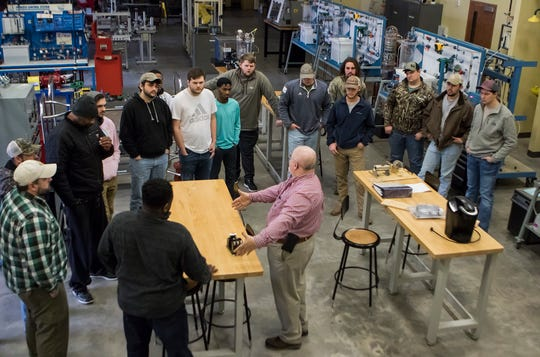 Mark Ketchell, center, teaches a motors and motor control class as part of in the high-bay classroom at Louisiana Delta Community College's instrumentation programs at the campus in Monroe, La. on Jan. 16. The program focuses on teaching students about the various motors used in manufacturing plants.