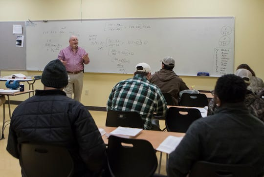Mark Ketchell teaches a motors and motor control class as part of Louisiana Delta Community College's instrumentation programs at the campus in Monroe, La. on Jan. 16. The program focuses on teaching students about the various motors used in manufacturing plants.