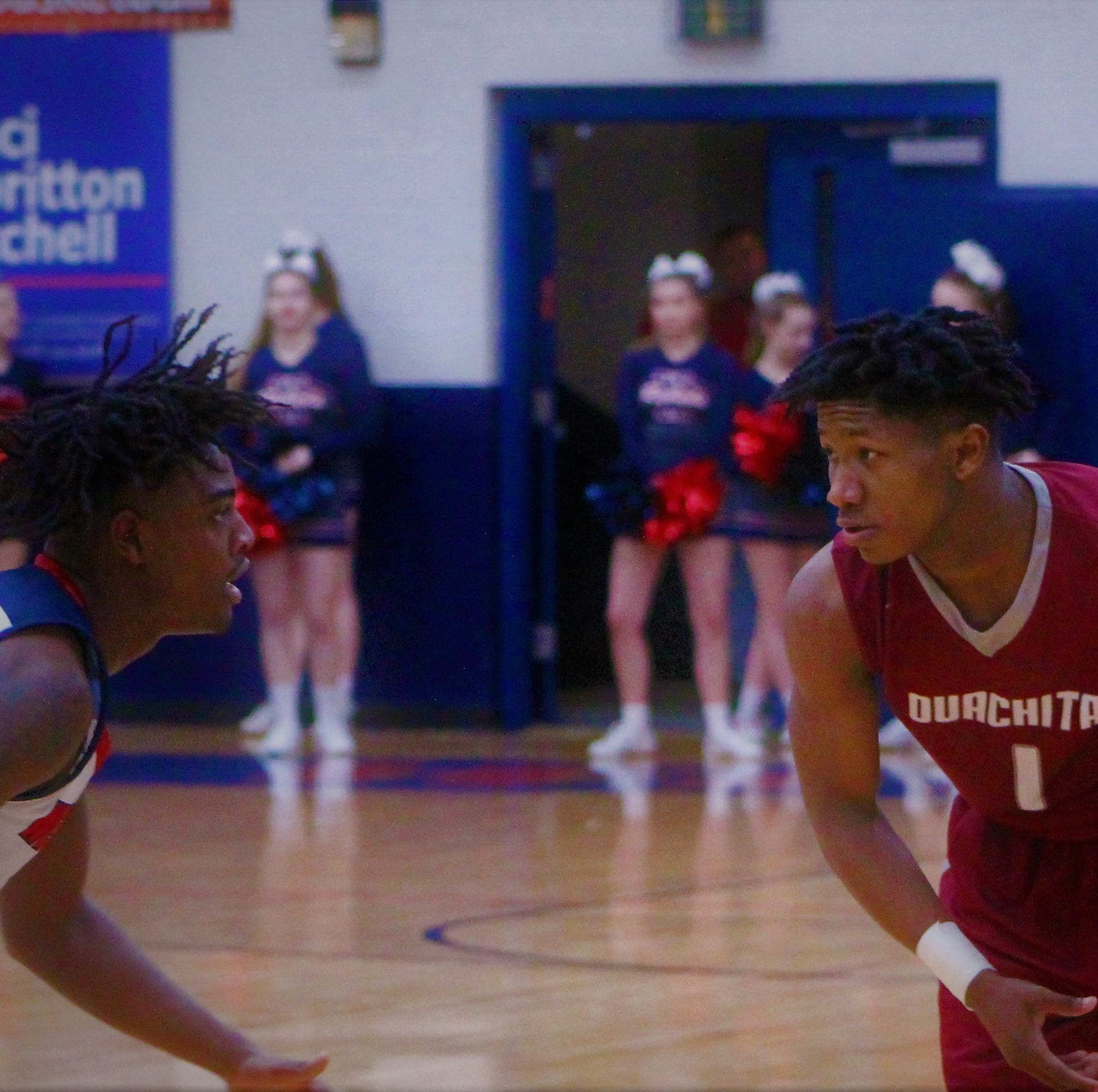 Ouachita Parish junior guard Quez Owens (1) looks to get past West Monroe junior Jerry Day, Jr. (4). Owens led the Lions in scoring with 17 points in Ouachita Parish's 66-33 victory over West Monroe in the District 2-5A opener for both squads at West Monroe High School's New Gym on Tuesday.