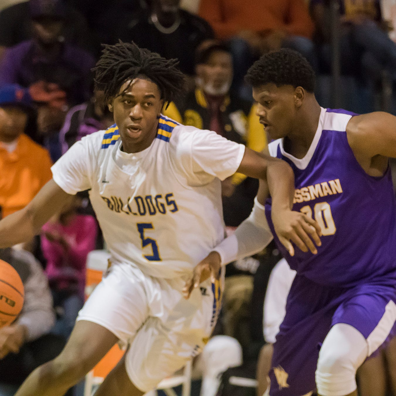 Carroll's Randy Jones (5) attempts to drive the ball against Wossman's Nick Traylor (10) during the game at Carroll High School in Monroe, La. on Jan 15.