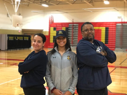 Mount Olive senior Naya Vialva (center) poses with her parents, Mona Ressaissi and Devon Vialva, after signing her National Letter of Intent with LaSalle soccer.
