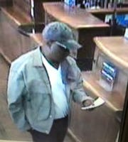 A suspect, later identified as James Matthews, before he allegedly handed a note to a bank teller demanding money during a robbery in Greenville.