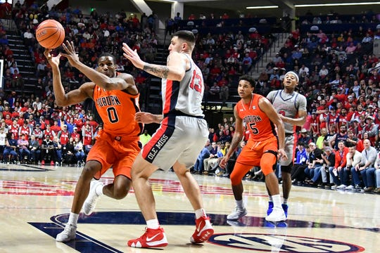 Auburn forward Horace Spencer (0) loses possession of the ball while guarded by Ole MIss center Dominik Olejniczak (13) on Jan. 9, 2019, in Oxford, Miss.