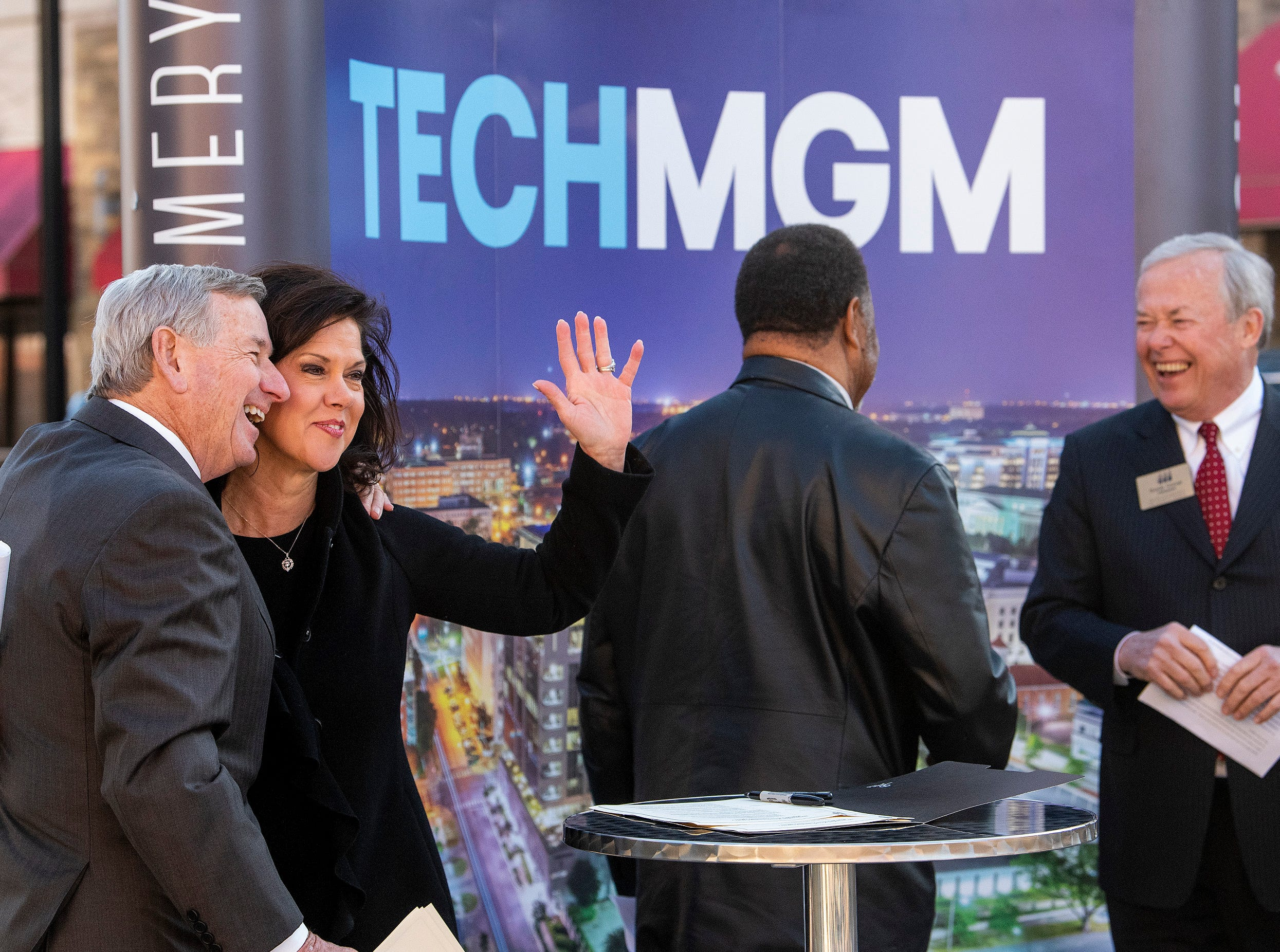 Montgomery Mayor Todd Strange, from left, Leslie Sanders of Alabama Power, Montgomery County Commission Chairman Elton Dean, left, Randy George of the Chamber of Commerce sign a pact as they announce free 1GB WiFi and other tech improvements along the Commerce Street / Dexter Avenue corridor in downtown Montgomery, Ala., on Wednesday January 16, 2019.