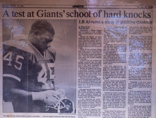 A newspaper feature story on now Jeff Davis High School Principal Bobby Abrams, from when he played for the Giants, hangs in Abrams office at the school in Montgomery, Ala., on Wednesday January 16, 2019.