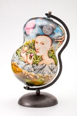 Kurt Weiser (American, born 1950), Random House (Globe), 2017, porcelain, glaze, china paint, and metal, 30 x 14 x 14 inches, Lent by the artist and Ferrin Contemporary, North Adams, Massachusetts