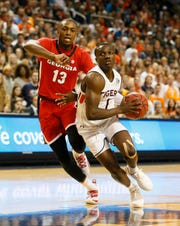 Auburn guard Jared Harper (1) goes for a shot as Georgia Bulldogs forward E'Torrion Wilridge (13) defends during the second half at Auburn Arena on Jan. 12, 2019.
