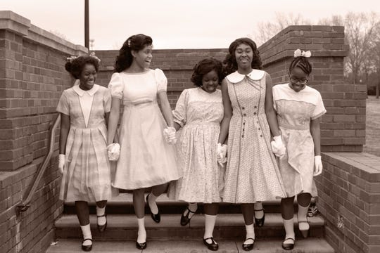 """Montgomery Public Schools students Gaia Moore, Trinity Ross, Jhordyn Long, Antonisia Collins and Jalyn Crosby in their Sunday dresses for the production of """"Four Little Girls"""" at the Alabama Shakespeare Festival."""