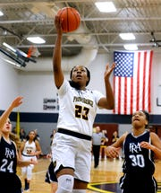Providence Christian's Yaubryon Chambers (23) goes up for a shot as Franklin Road Academy's Zharia Hutchinson (30) comes up from behind her on Tuesday Jan. 15, 2019.
