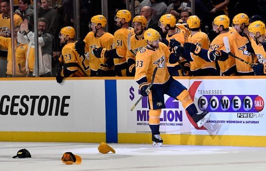 Predators right wing Viktor Arvidsson (33) celebrates his hat trick goal against the Capitals during the second period at Bridgestone Arena on Tuesday.