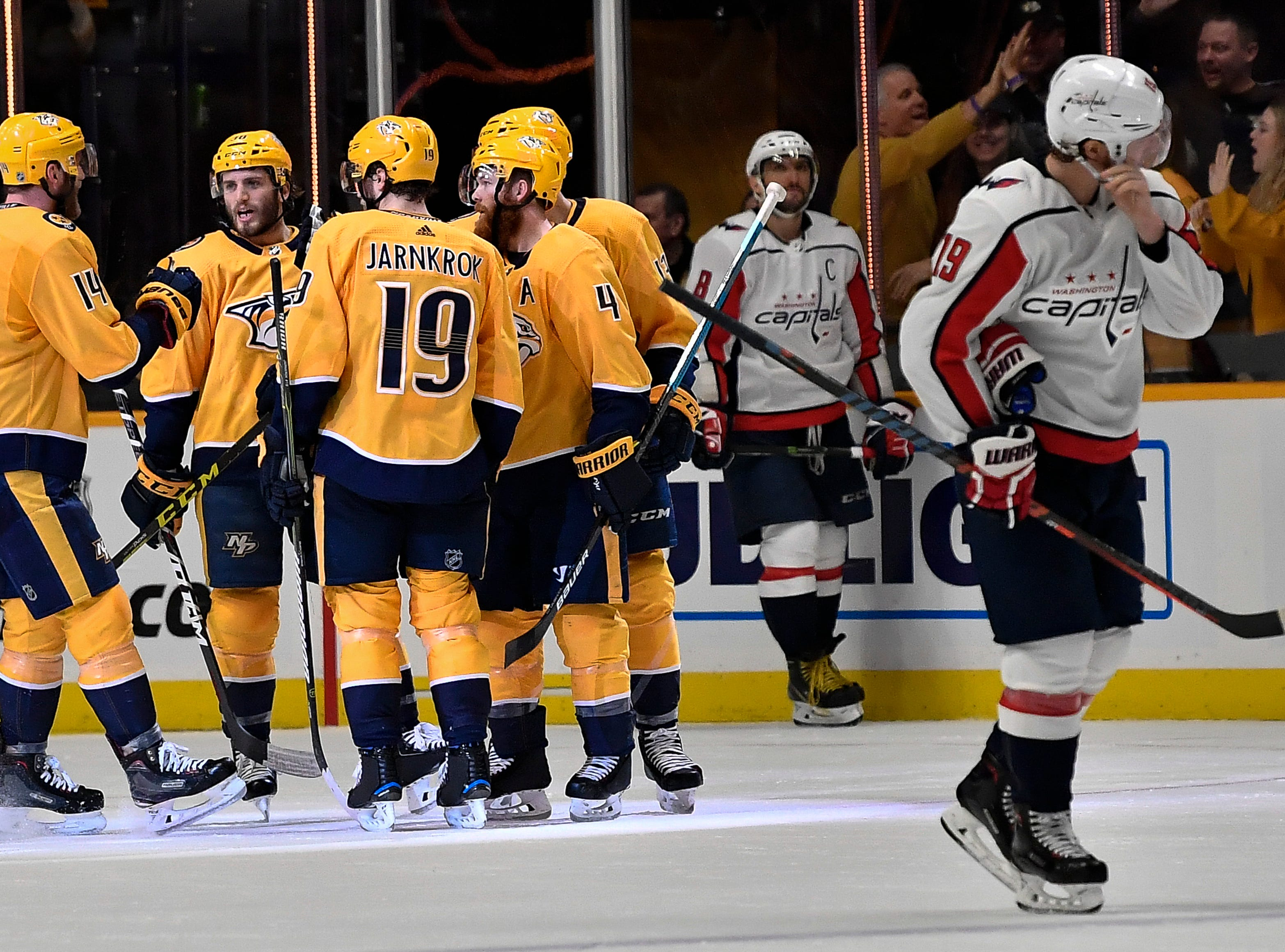 Predators center Nick Bonino (13) is congratulated by teammates after his goal against the Capitals during the second period at Bridgestone Arena Tuesday, Jan. 15, 2019, in Nashville, Tenn.